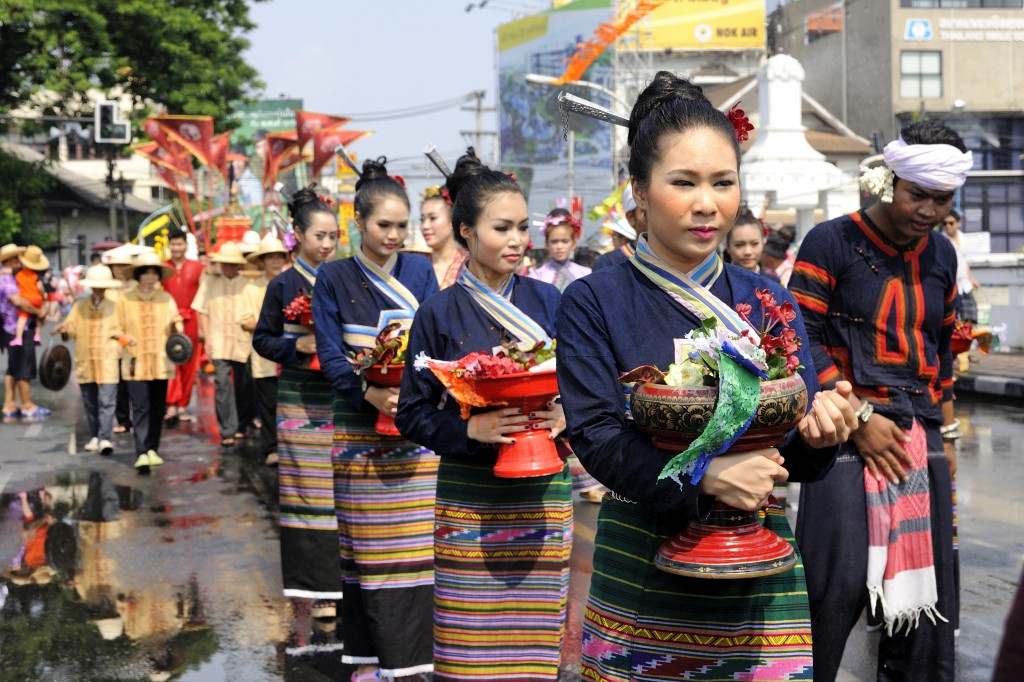 Chiangmai Songkran festival women wearing traditional clothing for a parade