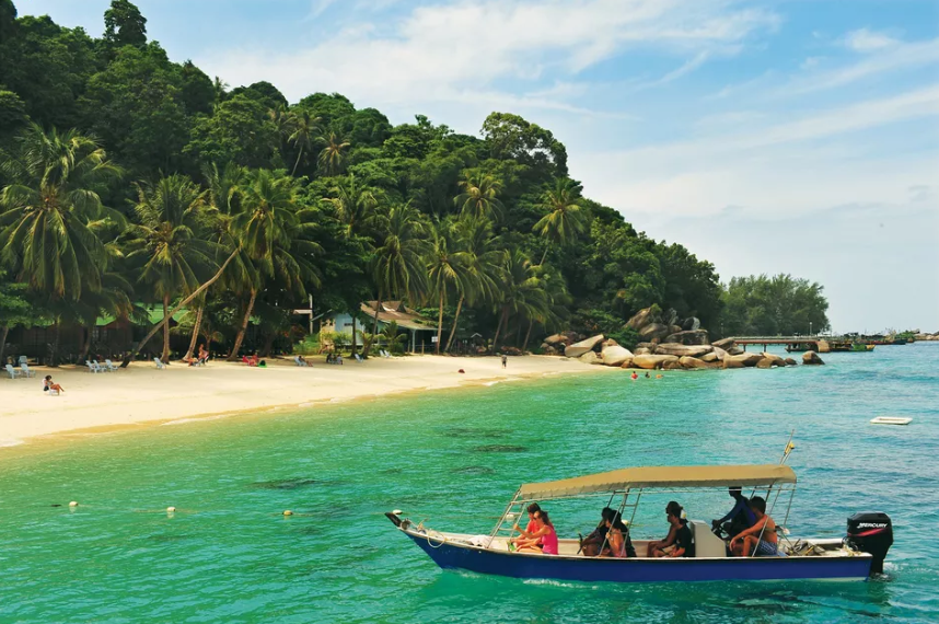 Travelerson boat reaching Perhentian Isands, Malaysia - nature lover