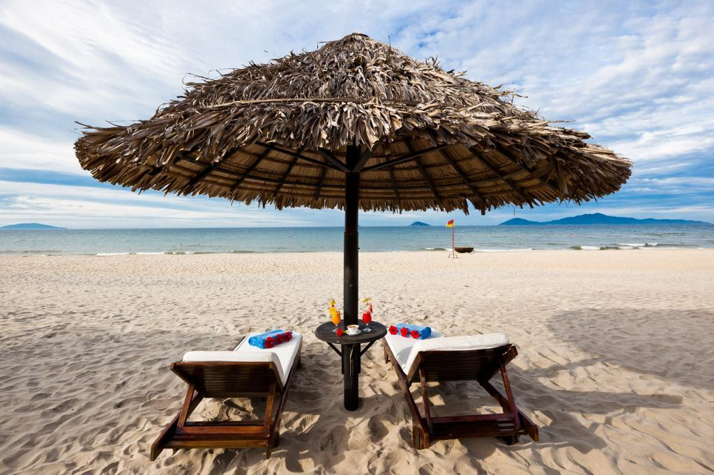Vietnam for families: White sand beach and cabana