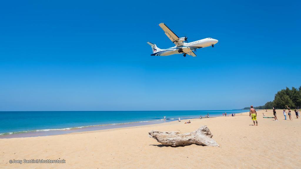 family holiday in Thailand: Mai Khao beach airplane flying through