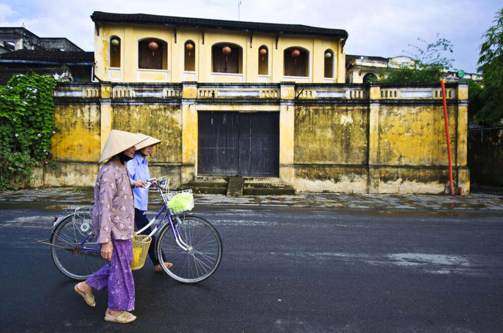 Two woman walk on Hoi an streets