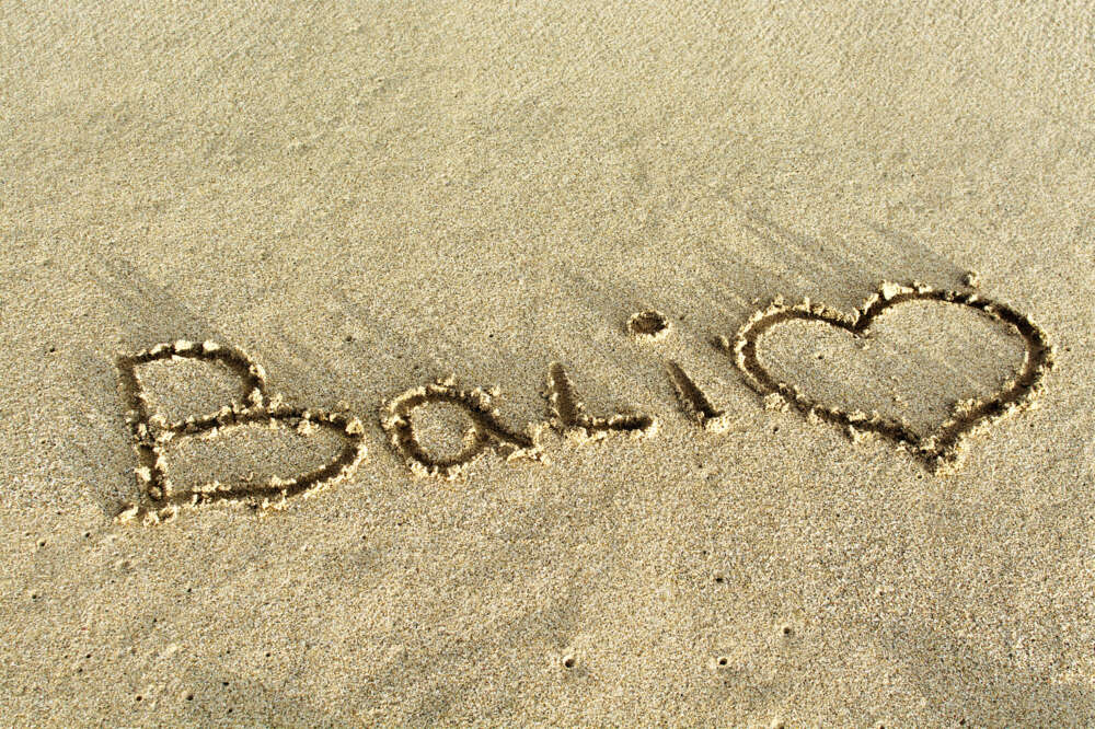 the word Balin and heart written in the beach sand