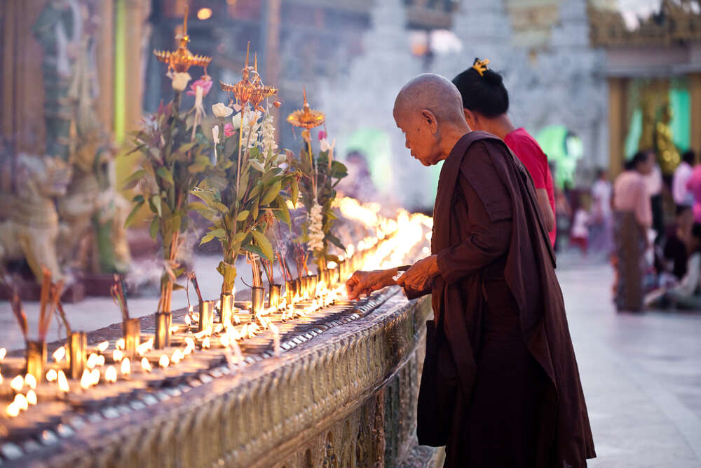 Myanmar luxury holidays: monk in a temple