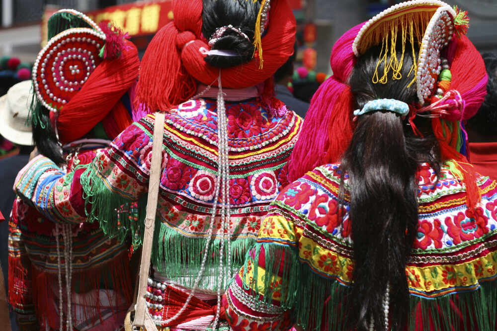 hill tribe girls dressed in colourful national dress in China