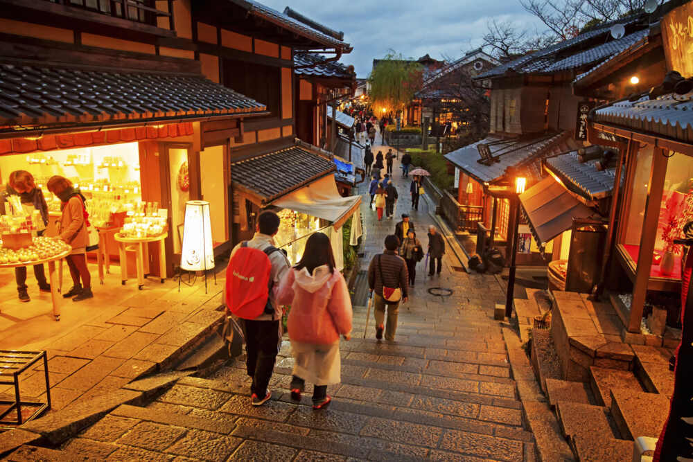 Japan cultural tours: Tourist walk in Kyoto streets