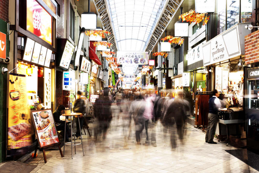 Shoppers in an indoor shopping arcade in Tokyo, Japan