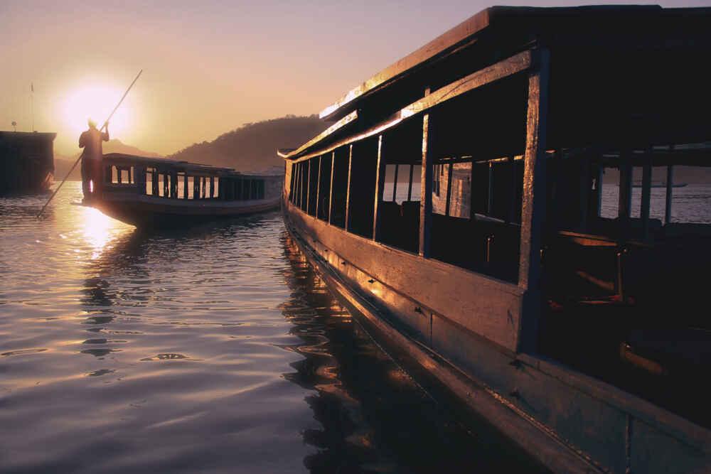 Relaxing tour of Laos: Mekong River cruising at sunset