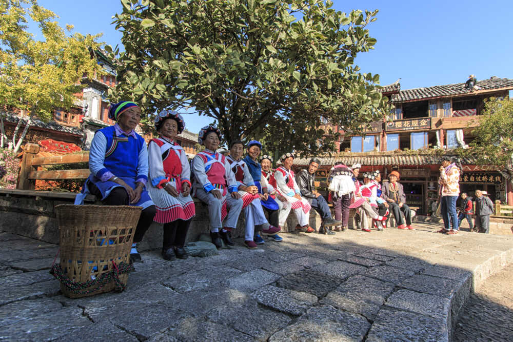 Old women dressed with the traditional attire, Lijiang Old Town