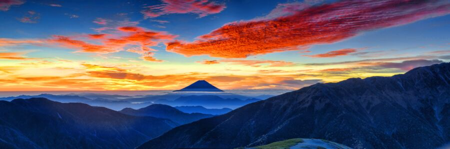 panorama of mount fuji at dawn with red clouds