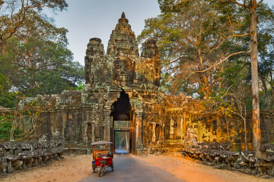 best honeymoon places in cambodia: Morning in Ruins of Angkor Wat, part of Khmer temple complex, Asia. Siem Reap, Cambodia. Ancient Khmer architecture in jungle.