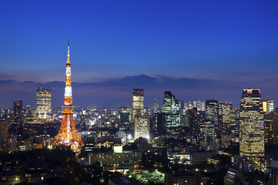 arrival in tokyo for a japan tour package: tokyo tower at night