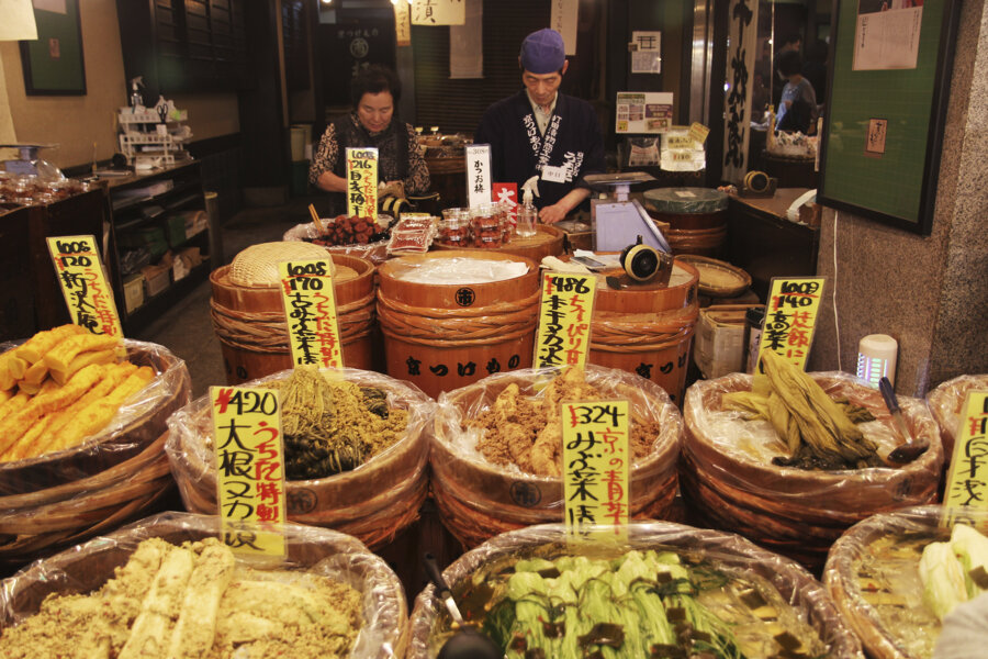 discover vendores in local traditional street market in kyoto on a japan tour package